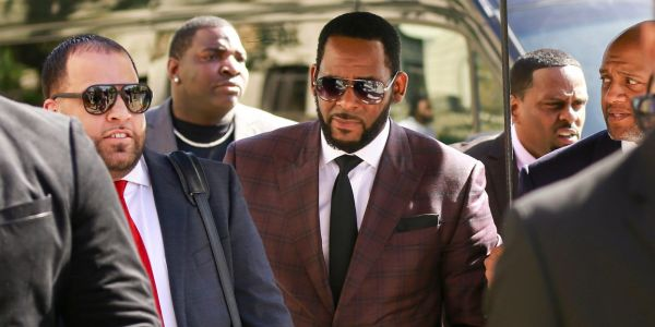 R. Kelly is accused with bribing a government employee to obtain fake ID to marry the late singer Aaliyah at age 15