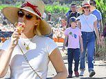 January Jones keeps cool with sunhat and ice cream on bonding day with son at pumpkin patch in LA