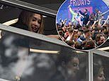 Myleene Klass leans out of window to get closer look at huge crowd of Scottish football fans
