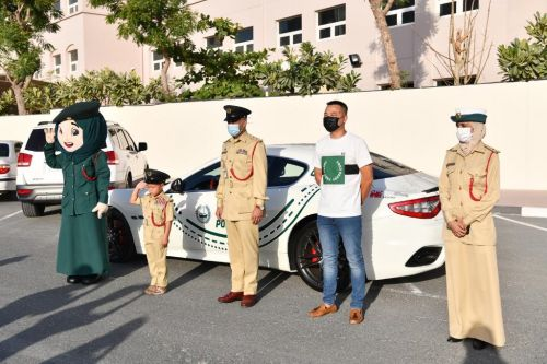 A Little Boy's Wish Was Granted After Dubai Police Let Him Ride A Luxury Police Car