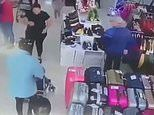 Shocking moment a woman tries to walk out of a Spanish shop with a mother's toddler