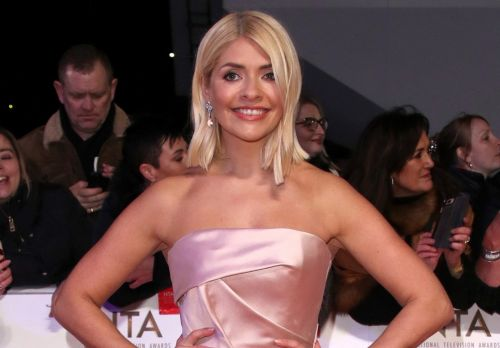 Holly Willoughby wows in Cinderella-inspired gown at the National Television Awards as she goes head-to-head with Phillip Schofield