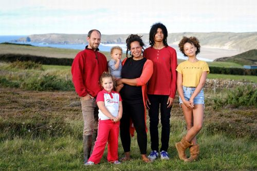 Family of six quit jobs and leave London to live off-grid in a caravan on a cliff