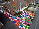 Pensioner, 74, boasts Britain's BIGGEST private flag collection with 680 banners