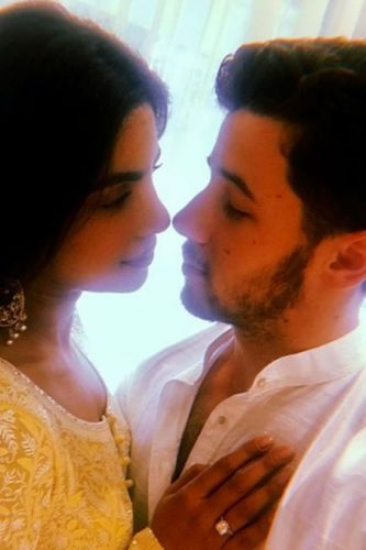 Nick Jonas and fiancée Priyanka Chopra fans think they've married after he posts 'wedding photos' online