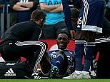Watford striker Danny Welbeck goes down injured after just 55 SECONDS against Tottenham