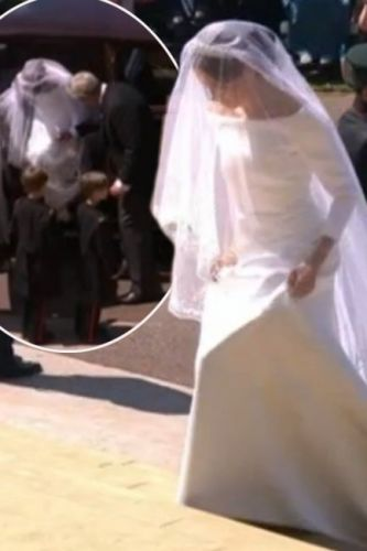Royal Wedding: Meghan Markle's wedding dress gets caught on her SHOE as she exits car to meet Prince Harry at Windsor Castle