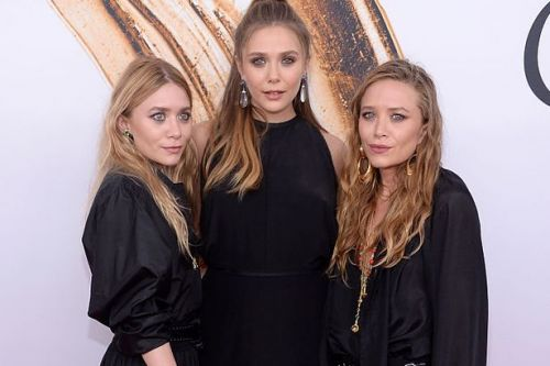 Mary Kate and Ashley's sister says it was 'insanity' growing up with child stars