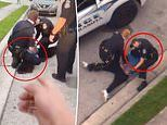 Florida policeman caught on camera with his knee on a black man's neck is placed on leave