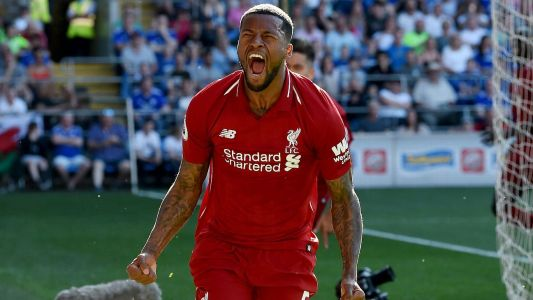 Liverpool go top after Wijnaldum, Milner goals down Cardiff