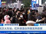 Swarms of Wuhan residents hit the road ahead of Chinese New Year amid global fears of deadly virus