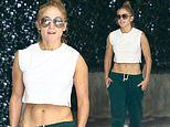 Jennifer Lopez puts her sculpted abs on display in white crop top as she steps out in Miami
