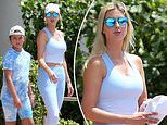 Ivanka Trump shows off her tan as she is pictured for the first time in two months with Arabella