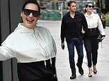 Kelly Brook looks loved-up as she arrives at work holding hands with beau Jeremy Parisi