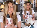 Jennifer Aniston beams with delight as she enlists the help of her pet pooches to reveal new LolaVie