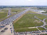 Thousands of unwanted new and used motors are stored on airfield as coronavirus slump hits economy