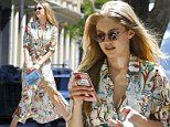 Gigi Hadid shows off her slender stems while rocking leggy floral shirtdress around NYC with friends