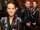 Kate Beckinsale works her trim physique in glossy wrap mini dress as she mingles with Lance Bass