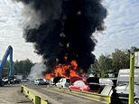 Massive car fire at recycling plant causes delays on M6 after sending thick black smoke into the air
