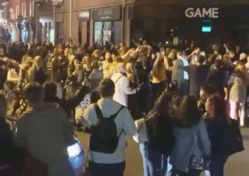 Brits swamp empty streets and dance around police after 10pm pub curfew