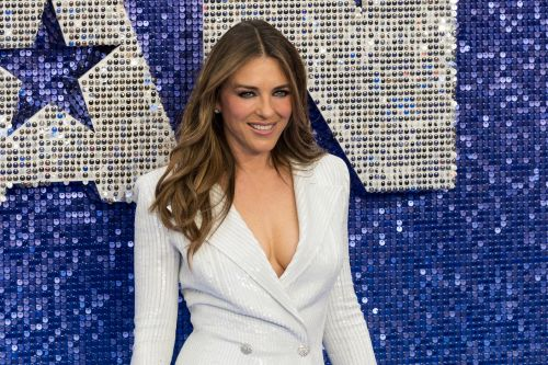 Liz Hurley gets ready for the holidays by wrapping herself up as a barely-there Christmas present