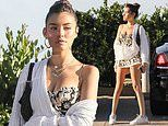 Madison Beer puts on a VERY leggy display in tiny floral mini dress as she enjoys lunch in Malibu