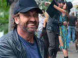Gerard Butler shares a giggle and a hug with pal who looks JUST like girlfriend Morgan Brown