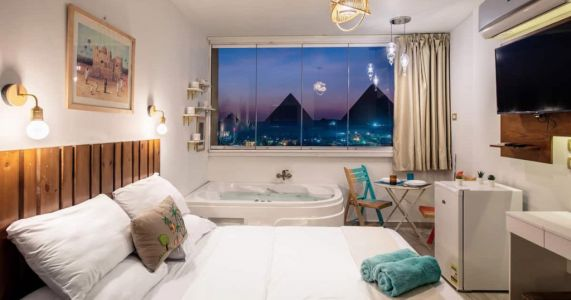 Enjoy incredible views of the Giza pyramids from a jacuzzi at this Airbnb - for just £55 per night