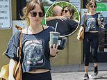Dakota Johnson flaunts fit figure in a crop top and leggings as she meets up with trainer
