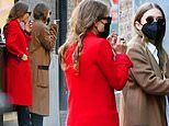 Mary-Kate and Ashley Olsen rock colored overcoats as they step out for a smoke break in New York
