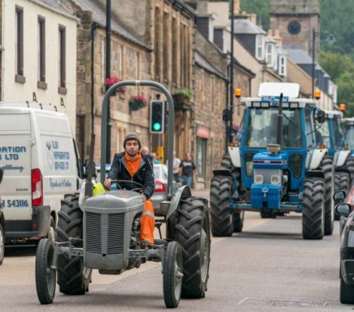 PICTURES & VIDEO: Spectacular display of vintage farm machinery parades through Moray to help local causes