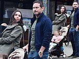 Christine Lampard and her husband Frank enjoy a dog walk in London with their two children