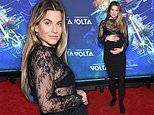 Rachel McCord shows off baby bump in figure-hugging dress at Cirque du Soleil's Volta premiere in LA