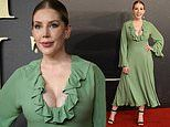 Katherine Ryan puts on a busty display in a plunging green ruffled dress at the Last Duel premiere