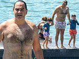 Michael 'Wippa' Wipfli enjoys a sun-soaked day at the beach with his sons Theodore and Jack
