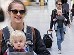 Teresa Palmer beams as she steps out with her one-year-old son Forest Sage at Adelaide airport