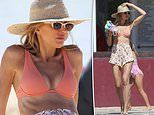 AFL WAG Bec Judd flaunts her rock-hard abs in Noosa with her family