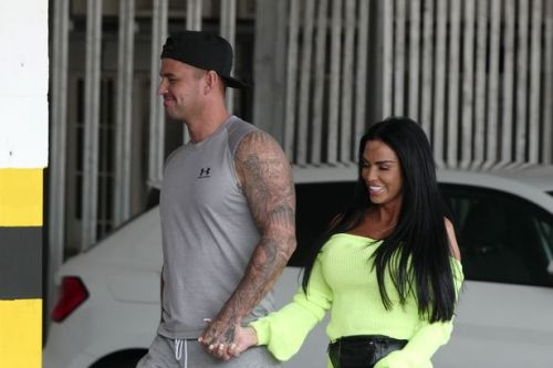 Katie Price looks loved-up with new man Carl Woods as Harvey remains in hospital