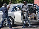 Prisoner is met by entourage after being released from jail before hopping into a ROLLS-ROYCE
