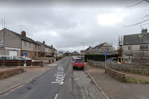 Human remains found in car on fire in Scots town as cops launch probe