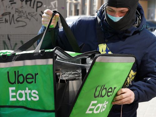 Uber's push to expand its food delivery empire just hit another roadblock as the DOJ scrutinizes its plan to buy Postmates