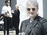 Kelly Osbourne rocks a long black overcoat for a lunch meeting with Jimmy Q in Los Angeles