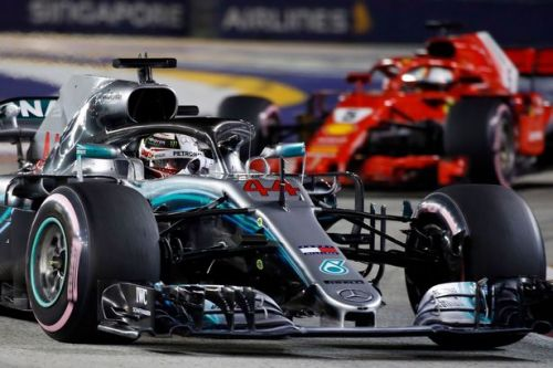 BREAKING: Lewis Hamilton wins Singapore Grand Prix to take 40 point Championship lead over Sebastian Vettel