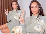 Kim Kardashian is covered in frosting for playful cake smash photo amid Kanye West divorce