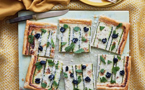 Courgette tart with black olives, ricotta and mint recipe
