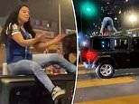Moment woman twerking on the roof of a Jeep gets dropped on her head during LA Dodgers celebrations