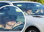 Britney Spears looks carefree as she cruises around in her car. after THOSE sexy Instagram shots
