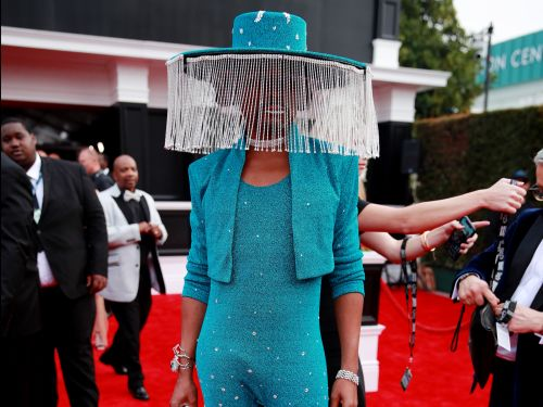 Billy Porter sparkled in a shimmering jumpsuit with a motorized fringe hat that covered his face at the 2020 Grammys