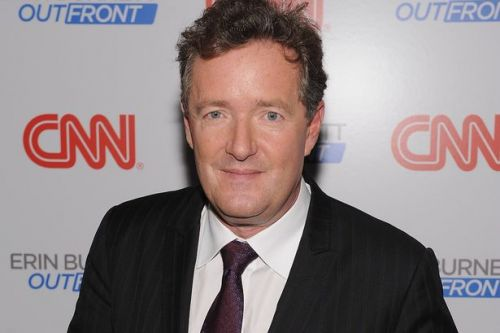 Larry King's talk show successor Piers Morgan leads tributes to late TV legend