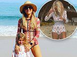 Carrie Bickmore rocks a stylish Rip Curl swimsuit on the beach in Byron Bay